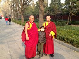 During our tour to the Lama Temple, our son met students traveling to the temple as well. , Vanessa V - February 2013