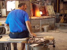 Here is a photo I took of one of the glass blowers working with the glass. He literally did blow the glass, and made a vase in front of our eyes. Amazing! , Sarah J - July 2016