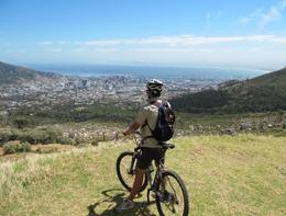 View of Cape Town's city bowl and waterfront from Table Mountain, perched atop a bike. - February 2010