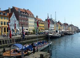 This photo shows the most famous canal scene in Copenhagen complete with a canal boat full of passengers. The photo was taken at one of our stops on the Grand Copenhagen Tour. , Gerald H - June 2011