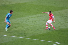 Ozil putting in a cross, hoping someone will get on the end of it, Bandit - May 2015