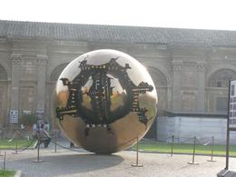 This is a HUGE revolving metal sculpture in the 'pine cone' courtyard of the Vatican., Ann K - October 2009