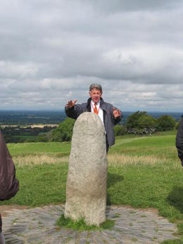 Our Tour Guide/Bus Driver, Michael, next to a Standing Stone at the Hill of Tara , MommaK - September 2013