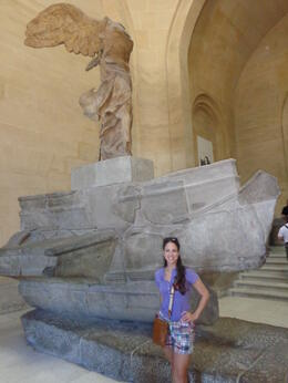 Admiring the famous sculpture of Nike of Somathrace , Claudia A - August 2013