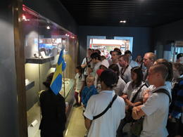 Our group listening to the guide tell us about jade making, Cat - July 2012