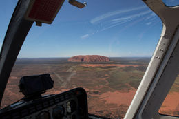 This is how we were introduced to Uluru - a wonder on the middle distance as we flew in from Ayres Rock airport - the pilot positioning our helicopter to give all a great view. , Catherine E - February 2015
