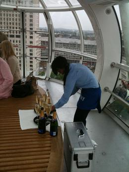 Our wonderful London eye attendant and the champagne, Travel Mom - July 2011