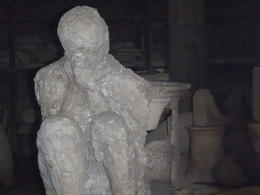 There is only a few plaster casts of the people of Pompeii left. Here is one. Best ruins ever!! , Catman2055 - December 2012