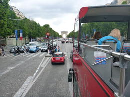 Driving along the Champs Elysees towards the Arc de Triomphe on the Car Rouges open top bus , Marie W - July 2012