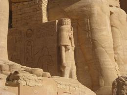 Smaller statue of Queen Nefretari at the foot of Rames at Abu Simbel , Ronald M - September 2011