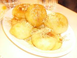 Loukumades served at a traditional greek tavern. Delicious , ricotarola - June 2012