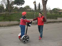 Theresa in Rome learning how to navigate the Segway. Our instructor explained to me how the Segway works and though I was rough around the edges, he was patient and led me through the streets of ... , Theresa L - March 2008