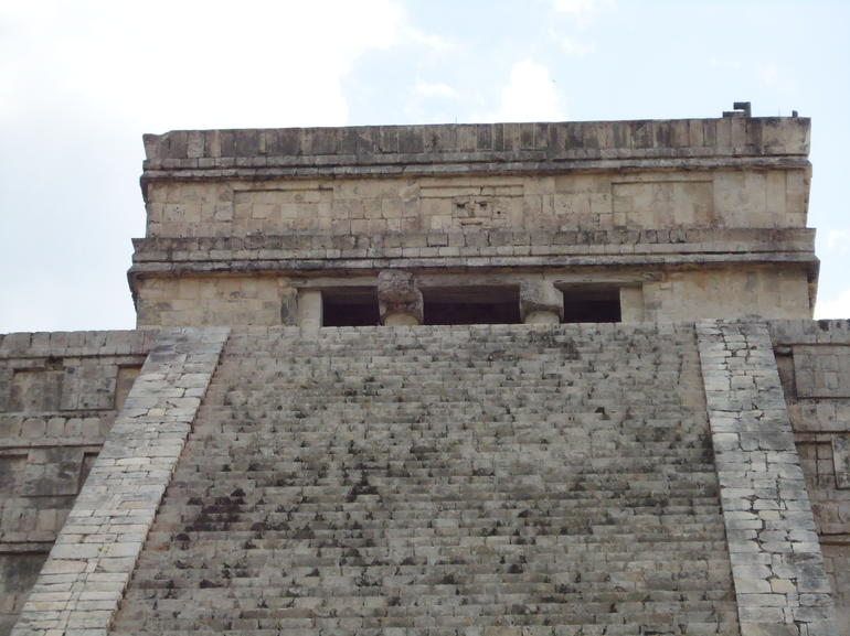 Kukulcan Pyramid with engraved face on the temple. - Cancun