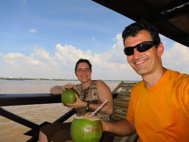 Savoring a nice fresh coconut - Ho Chi Minh City