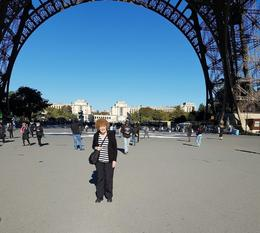 Me standing under the Eiffel Tower before we went up the Tower. , Roma S - October 2016