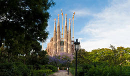 The iconic spires and ornate Passion façade of Antoni Gaudí's Sagrada Família, the immense church still being built in L'Eixample district of central Barcelona framed by the colorful... - May 2011