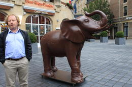 "Our tour guide, Marc, and the Chocopolis ""Chocolate"" Elephant mascot. , Destini K - November 2012"