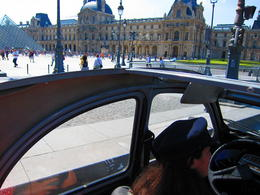 A view of the enormous Louvre Museum with its Pyramid in the courtyard from our 2CV, Barrie S - September 2011