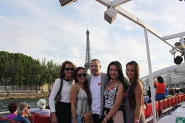 The cousins took a trip to Paris together. We asked a nice lady to take our photo. This is a view from the Seine River with the Eiffel Tower behind us. It was breathtaking. , Rosalie N - May 2014