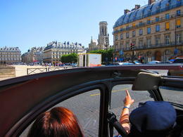 Our guide/driver/ pointing out Notre Dame as we approach from the northwest side..., Barrie S - September 2011