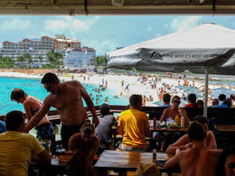 Have a drink or some food at the bar overlooking Maho Beach. , PENELOPE L - September 2013