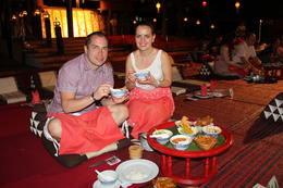 We are Manuela (Bulgaria) and Denis (Latvia) who enjoy the tasty food and watch the traditional dancings. , Deniss M - March 2014
