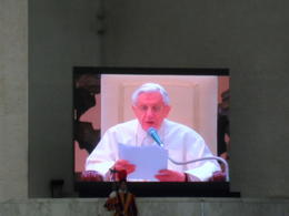 The pope in a big screen talking about his visit to the middle East , J. Raul C - September 2012