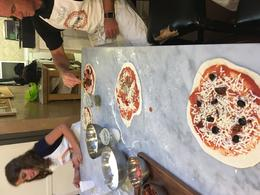 Pizzas are prepped to go into the pizza oven. , Jennifer K - July 2017