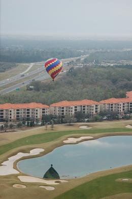 One of the other several balloons, flying that morning... Flying over the lake, at the hotel..., Michael B - March 2010