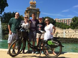 Us with one of our ebikes posing in front of the fountain in Citadel Park , Christine W - June 2015