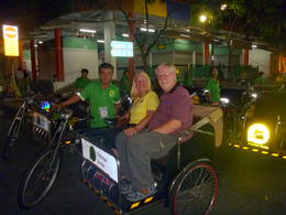 Jackie and Jim get onboard their trishaw and are ready for a ride around Singapore's Chinatown. , James S - June 2013
