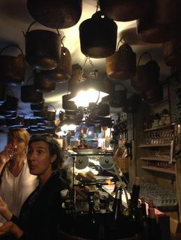 Our guide was describing the pots on the ceiling and pointing out the large casks of wine. None of the little bars were big, so they are intimate and fun. , John E. M - October 2014