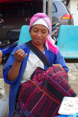 A local woman doing embroidery - roadside market in Doi Mae Salong , Darren Meg L - April 2015