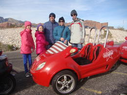 Our family with one of the cars we drove - fun! , Craig S - January 2015
