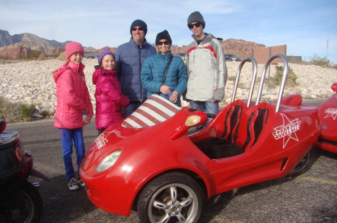 Our family with one of the cars we drove - fun!
