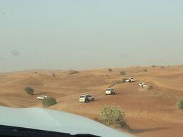 A line of Desert Gate vehicles dune bashing , Chris M - July 2016