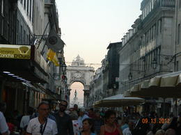 very pretty street, lined with restaurant tables and huge crowds, very festive , R The Traveler - October 2012