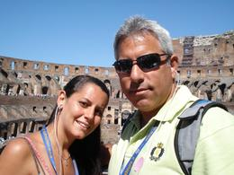 My daughter and I have our picture taken by my wife inside the Colosseum as our tour guide tells us what we are seeing over the audio phones. Amazing!, David F - July 2008