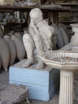The body of a man - possibly a thief as he is surrounded by coins - who returned to Pompeii the day after the first eruption and was caught by the second eruption which covered the city in ash and..., Maria A B - November 2014