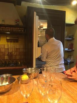 Our guide getting some wine out of the fridge. , Debra M - September 2016
