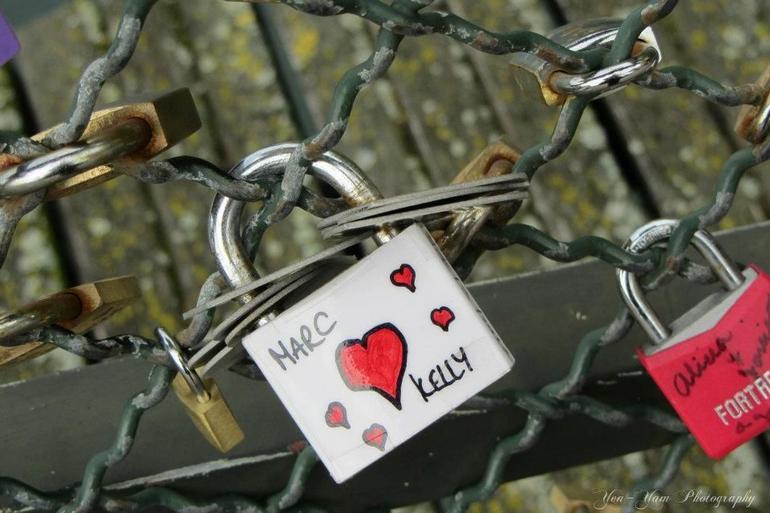 Padlocks in Pont des Art Bridge. - Paris