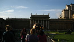 Tourists inside a plaza in the Vatican showing the Unisphere , James Y M - October 2014
