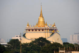 Golden Mount temple (Wat Saket) across the rooftops in Bangkok (view from tuk tuk) - June 2011