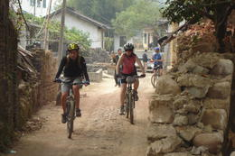 Biking through one of the local villages - May 2012