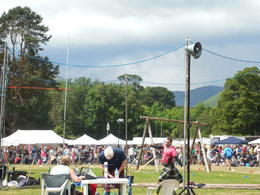 Competitors participating in traditional highland sports. , J A H - July 2014