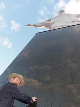 Touching the base of the statue. , Thomas S - June 2011