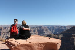 Sitting on the edge overlooking the majestic Grand Canyon , June D - October 2012