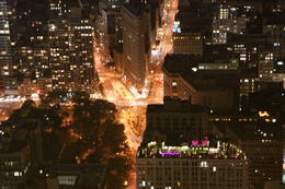 The Flatiron Building by night, illuminated by the traffic on 5th Avenue and Broadway taken from 82 stories above Manhattan. , louby - March 2011