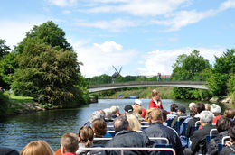 The canal tour boat heading for one of the many bridges, in the distance, a windmill in one of the many parks. , Richard H - June 2015
