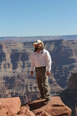 Take this tour - you won't be disappointed. Here's Brett, standing on the edge! He is a fantastic guide, made our day trip to the Grand Canyon very very special indeed! , June D - October 2012